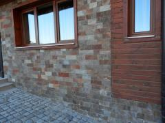 Facing tile for facades