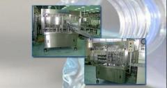 Machine for automatic filling and capping of