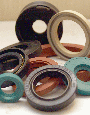 Seals for pistons and shafts