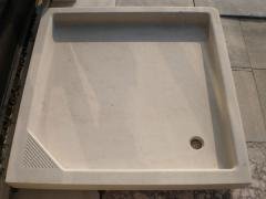 Trays for shower cabins